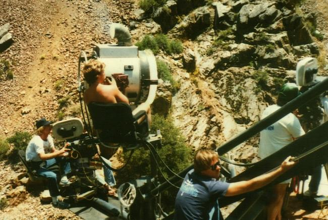 Randy Lewis operating an arc on a Chapman Crane on a bridge over the Kern River, 1982 (Photo by Doug Mathias).